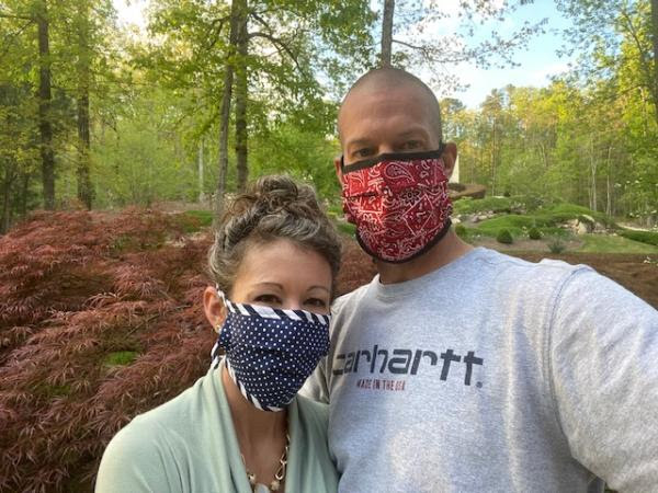 Dr. Bishop and husband in mask